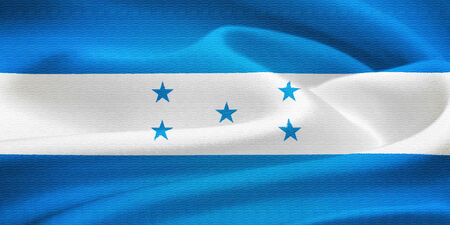 flag of  Honduras waving in the wind. Silk texture pattern photo