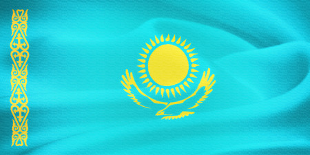 former: flag of Kazakhstan waving in the wind. Silk texture pattern Stock Photo