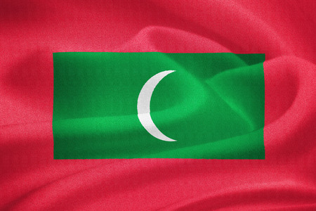 maldives island: Flag of the Maldives waving in the wind. Silk texture pattern