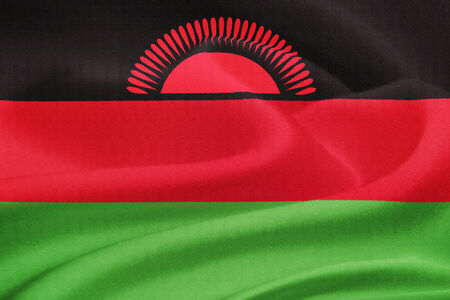 malawian flag: flag of Malawi waving in the wind. Silk texture pattern