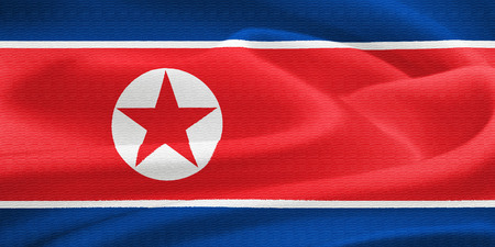 pyongyang: flag of North Korea waving in the wind. Silk texture pattern Stock Photo