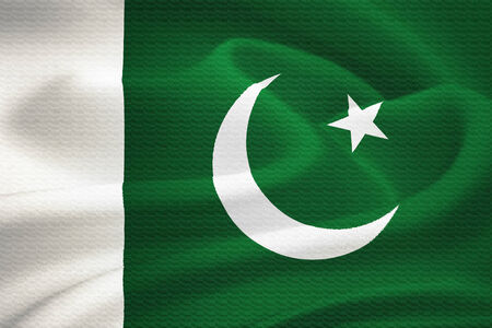 islamabad:  flag of Pakistan waving in the wind. Silk texture pattern