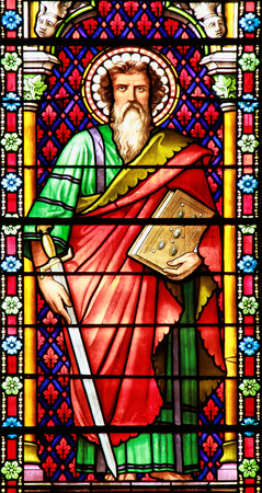 Apostle  Stained glass window in the Cathedral of Meze, South of France photo