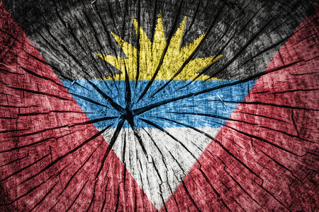 detachment: flag of  Antigua and Barbuda on cracked wooden texture