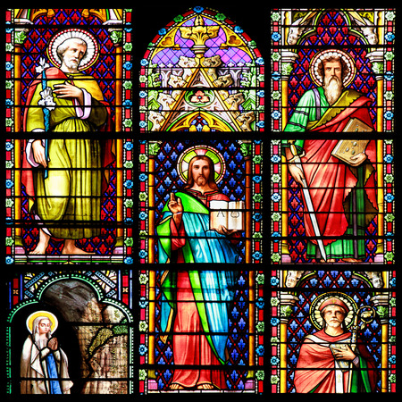 Photo collage of Scenes of the Bible  Stained glass window in the Cathedral of Meze, South of France