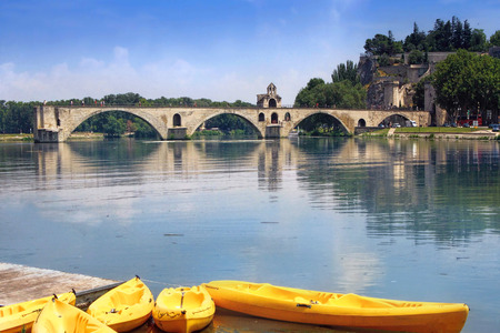 yellow boats: The medieval bridge in the town of Avignon, in southern�France with yellow boats   from Island of Barthelasse