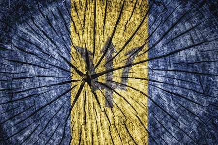 britannia: flag of  Barbados on cracked wooden texture