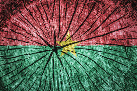 wood cross section: Flag of Burkina Faso on cracked wooden texture Stock Photo