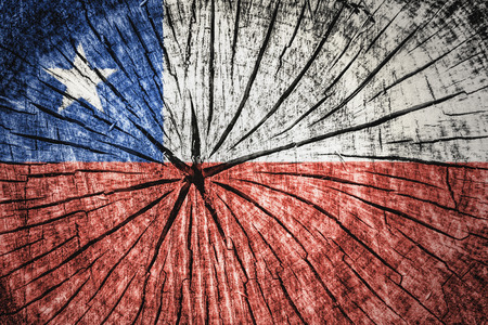 Flag of Chile on cracked wooden texture