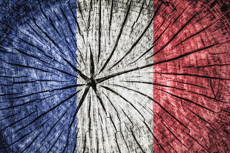 detachment: flag of France on cracked wooden texture Stock Photo