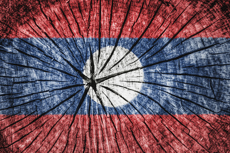 flag of Laos on cracked wooden texture