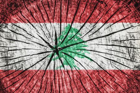 wood cross section: flag of Lebanon on cracked wooden texture Stock Photo