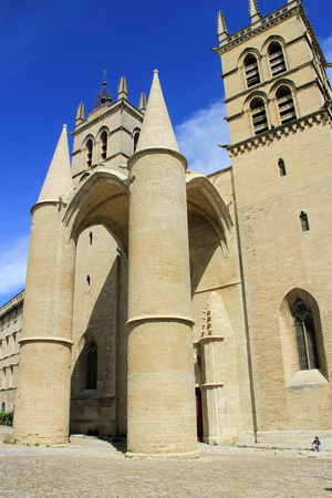 MONTPELLIER, FRANCE - MAY 27, 2014: a student sitting in front of Saint Pierre Cathedral on May 27, 2014 in Montpellier, France France