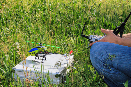 power operated: Piloting Radio controlled helicopter  with remote control.