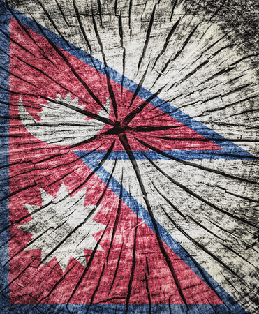 flag of Nepal on cracked wooden texture