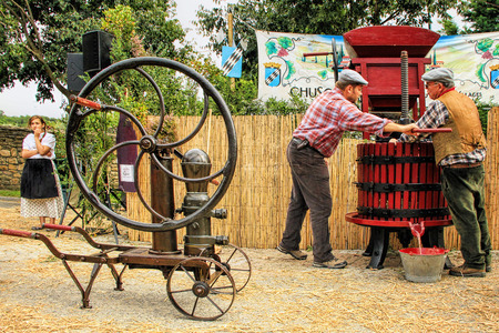 CHUSCLAN, FRANCE - October12, 2013: Traditional Wine Pressing using a manual grape crushing machine during the festival grape harvest of the history October 12 and 13, 2013, in Chusclan, France.