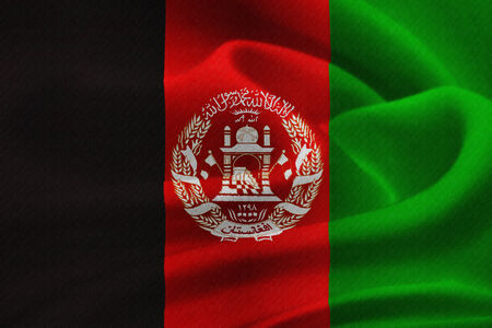 afghan flag:  flag of Afghanistan waving in the wind. Silk texture pattern Stock Photo