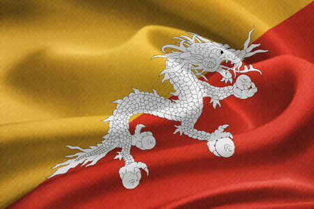 lineage: flag of Bhutan waving in the wind. Silk texture pattern Stock Photo
