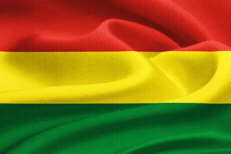 Flag of Bolivia  waving in the wind. Silk texture pattern photo