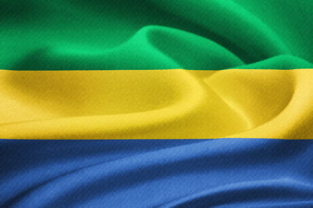 pygmy: Flag of Gabon waving in the wind. Silk texture pattern Stock Photo