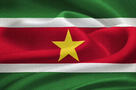 Flag of Suriname  waving in the wind. Silk texture pattern photo