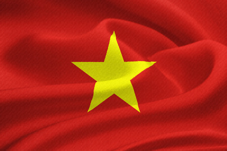 indochina peninsula: Flag of Vietnam waving in the wind. Silk texture pattern