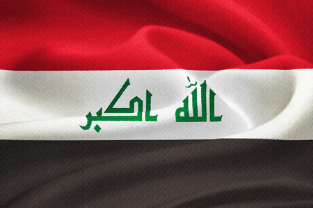 liberation: flag of Iraq waving in the wind. Silk texture pattern