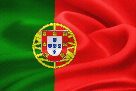 Flag of Portugal waving in the wind. Silk texture pattern photo