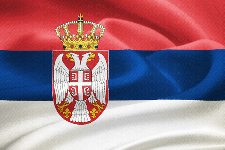 double headed: Flag of Serbia waving in the wind. Silk texture pattern Stock Photo