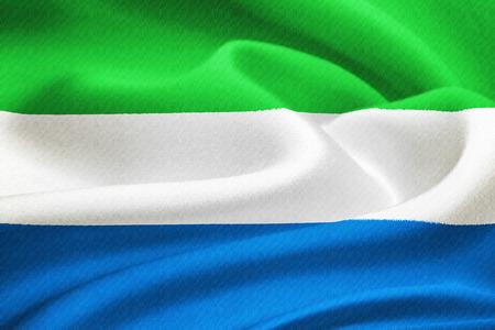 Flag of Sierra Leone waving in the wind. Silk texture pattern photo