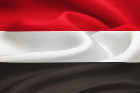 aden: Flag of Yemen waving in the wind. Silk texture pattern Stock Photo