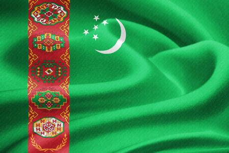 gaz: Flag of Turkmenistan waving in the wind. Silk texture pattern Stock Photo