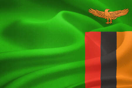 zambian flag: flag of Zambia waving in the wind. Silk texture pattern