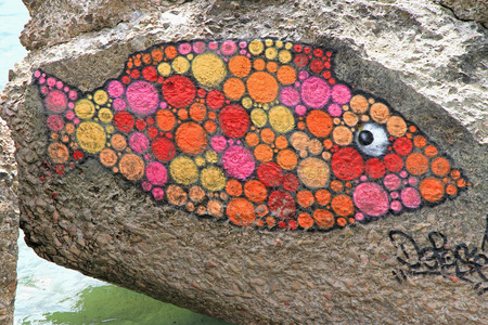 SETE, FRANCE - September 21, 2014:  Graffiti fish on a stones of a breakwater in Sete, south of France