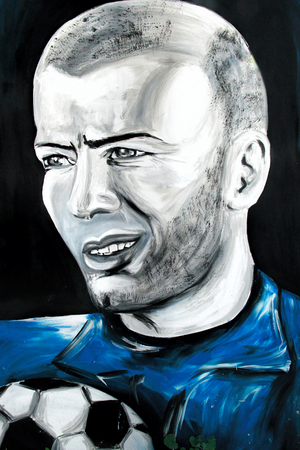 SETE, FRANCE  - SEPTEMBER 21, 2014: Graffiti portrait of Zinedine Zidane, a famous French footballer on the wall of Sete, south of France.