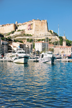 BONIFACIO, CORSE, FRANCE - September 14, 2013: Harbor of Bonifacio -  the oldest town in Corsica extends for some distance along the cliff-tops (the cliffs are listed in the UNESCO world heritage)