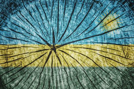 kigali: flag of   Rwanda on cracked wooden texture