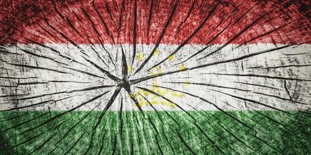 detachment: Flag of Tajikistan on cracked wooden texture