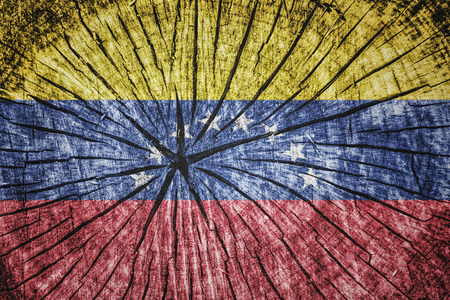 republic of colombia: flag of  Venezuela on cracked wooden texture