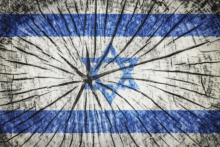 flag of Israel on cracked wooden texture Imagens