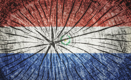 flag of Paraguay on cracked wooden texture photo