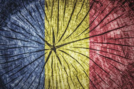 detachment: Flag of Romania on cracked wooden texture Stock Photo