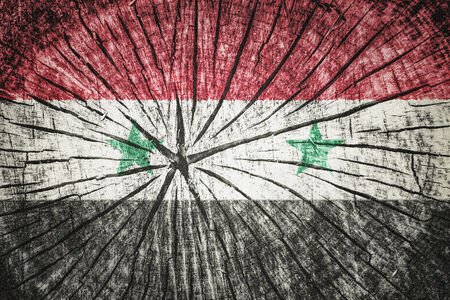 al assad: Flag of Syria on cracked wooden texture Stock Photo