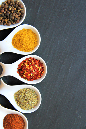 black peppercorn: From  up to down: Black Peppercorn, curry powder, espelette chili, Provencal Herbs, paprika, Stock Photo