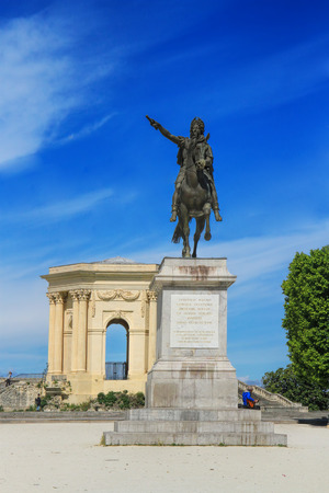 MONTPELLIER, FRANCE - MAY 27, 2014: Arc de Triomphe and Statue of Louis XIV on horseback, in Peyrou Garden in Montpellier, France Editorial