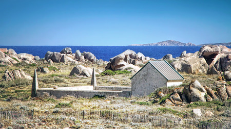 View Lavezzi island with stone formation and One of the two cemeteries where victims of the Semillante shipwreck were buried photo