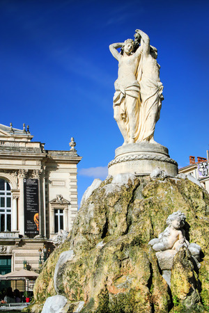 MONTPELLIER, FRANCE - MAY 27, 2014: National Opera theater of Montpellier with three Graces fountain. (Built in the Italian style in 1888 ) on May 27, 2014 in Montpellier, France