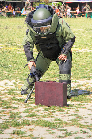 Bomb Squad specialiste and vehicle equipped with a remote-controlled robot, detection and detonation equipment photo