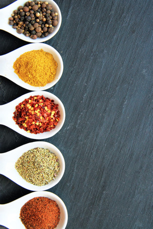 close up food: From  up to down: Black Peppercorn, curry powder, espelette chili, Provencal Herbs, paprika, Stock Photo
