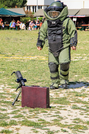 munition: LAUDUN, FRANCE - MAY 01, 2014: Bomb Squad specialiste and vehicle equipped with a remote-controlled robot, detection and detonation equipment during French Foreign legion open Day on May 01, 2014 Editorial